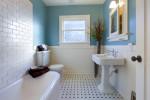 Baño vintage con suelo a topos