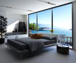 Dormitorio costero minimalista con tonos en blanco y negro