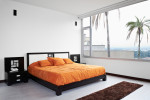 Dormitorio de estilo ecléctico con color naranja