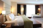 Dormitorio moderno con gran reposacabezas