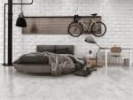 Dormitorio de estilo industrial con ladrillo visto