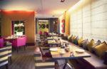 Cafetería ecléctica con sofás a rayas