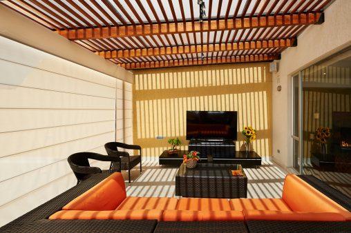terraza eclctica con muebles de ratan - Terrazas Cerradas