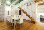 Comedor nórdico con escalera de madera
